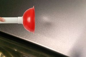 A Toilet Plunger Can Be Used to Repair a Ding